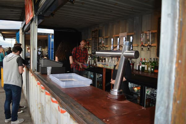 shipping container pop up bar - the boy who climbed out of his face