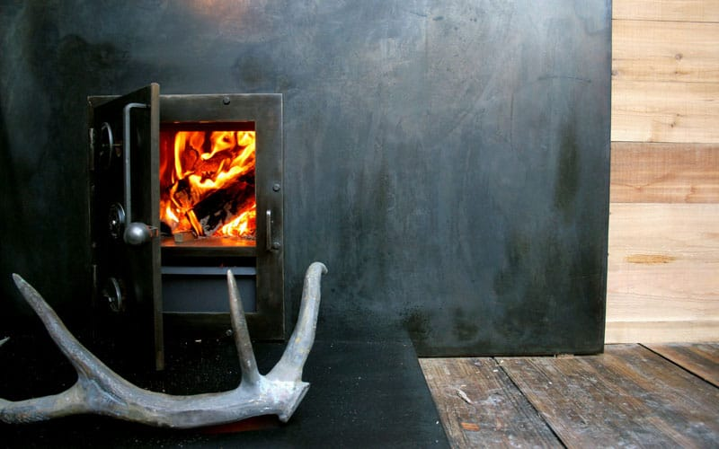Wood stove inside shipping container sauna