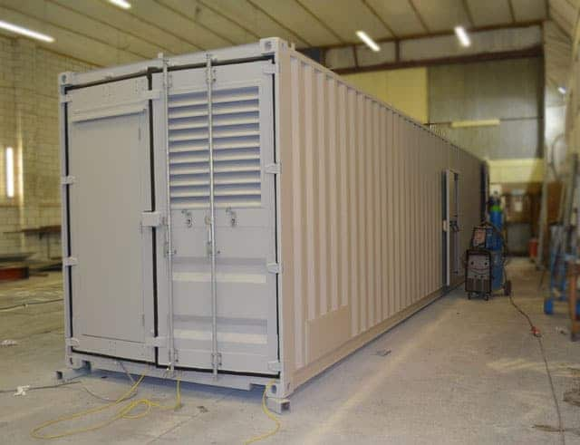 Shipping container for boiler room housing.